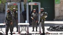 Israeli border police stand beside a newly installed metal detector at a main entrance to the Temple Mount, also called Noble Sanctuary by Muslims, near the Lion's Gate in Jerusalem's Old City, July 16, 2017. Israeli security reopened the Temple Mount after installing added security measures, including metal detectors and cameras, after the holy site was closed since three Israeli Arabs killed two Israeli police officers in a shooting attack on Friday. The heads of the Jerusalem Islamic Waqf refused to enter the holy site through the Israeli metal detectors and organized a prayer outside the mosque compound. - Photo by Debbie Hill/UPI Photo via Newscom picture alliance |