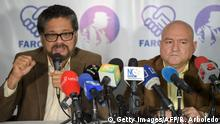FARC commanders Ivan Marquez (L) and Carlos Lozada speak at a press conference in Bogota launching a political party in Bogota.