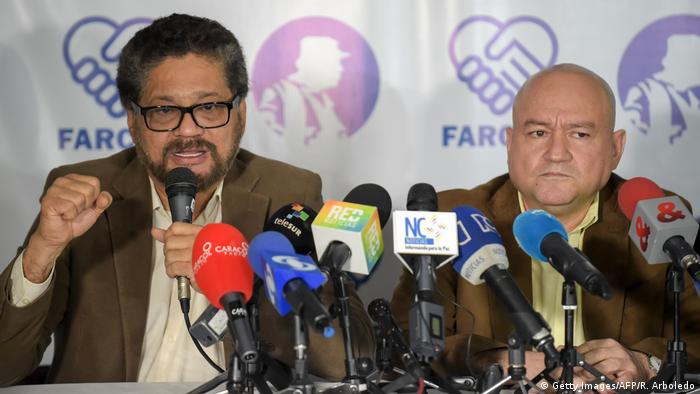 FARC commanders Ivan Marquez and Carlos Lozada deliver a press conference