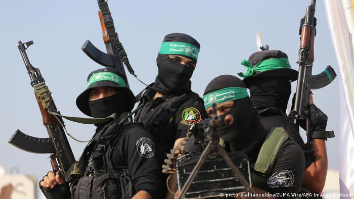 Hamas soldiers holding up guns