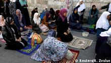 25.07.2017 *** Palestinian women pray outside the compound known to Muslims as Noble Sanctuary and to Jews as Temple Mount at morning after Israel removed the new security measures there, in Jerusalem's Old City July 25, 2017. REUTERS/Ronen Zvulun