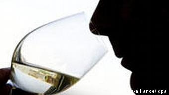 Backlit image of a man drinking wine