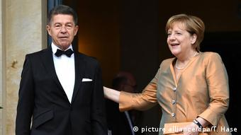 Joachim Sauer and Angela Merkel