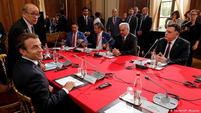 French President Emmanuel Macron, Libyan National Army General Khalifa Haftar and Prime Minister Fayez al-Sarraj