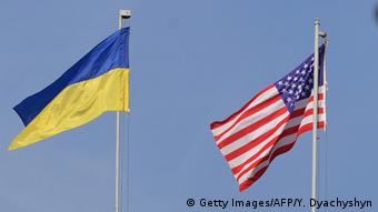 Ukranian and US flags fly