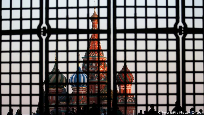 St. Basil's Cathedral is seen through a gate in Red Square