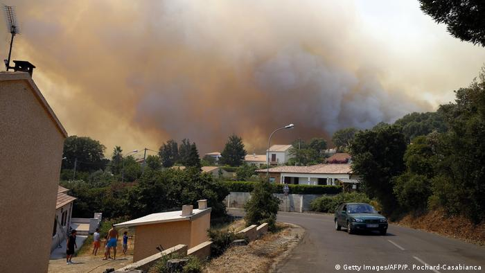 Smoke rises beyond a home in Corsica (Getty Images/AFP/P. Pochard-Casabianca)