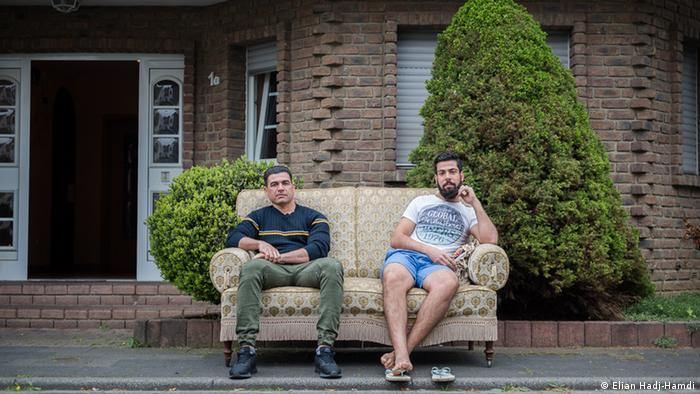 2 men from Njaf, Iraq sit in front of their temporary home in Manheim (Elian Hadj-Hamdi)