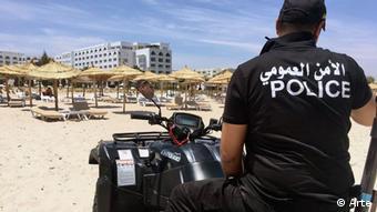 Policeman on beach in Tunisia