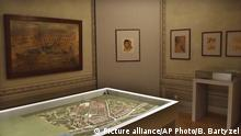 This photo made available by the Auschwitz Museum on Wdnesday July 12,2017 shows a model of a plan the German Nazis were making for the enlargement of the Auschwitz death camp. Made by inmates, it is one among some 200 drawings and other pieces of art now on display at a Face to Face. Art in Auschwitz exhibition of art by the inmates at the Szolayski house in Krakow, Poland. (Bartosz Bartyzel/Auschwitz Museum via AP) |