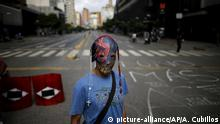 Venezuela protester wearing a mask