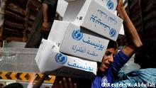A volunteer carries hygiene kits provided by UNICEF, amid a cholera outbreak, in Sanaa, Yemen, May 24, 2017. REUTERS/Khaled Abdullah SEARCH CHOLERA KHALED FOR THIS STORY. SEARCH WIDER IMAGE FOR ALL STORIES.