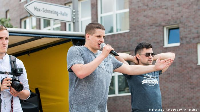 The leaders of Germany's and Austria's Identitarian movements speaking at a rally (picture-alliance/dpa/F. M. Steiner)