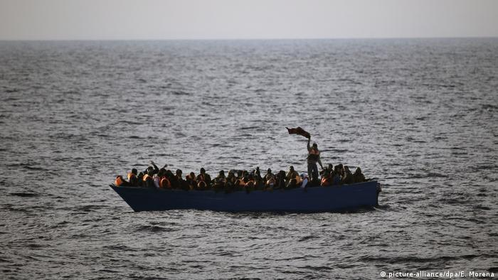 Stranded people in a boat off the coast of Libya