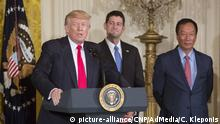 United States President Donald J. Trump makes remarks during the announcement of the creation of a Foxconn Factory to be built in Wisconsin to build LCD flat screen monitors at The White House in Washington, DC, July 26, 2017. With Trump are the Speaker of The US House Paul Ryan (Republican of Wisconsin), and Foxconn CEO Terry Gou (right). Photo Credit: Chris Kleponis/CNP/AdMedia |