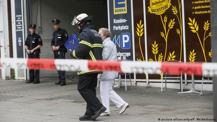 German police assist an elderly woman after a knife attack in Hamburg