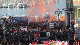 Several thousand French workers demonstrate during a protest march past the old port in Marseille