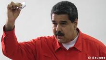 30.07.2017 Venezuelan President Nicolas Maduro show his ballot as casts his vote at a polling station during the Constituent Assembly election in Caracas, Venezuela July 30, 2017. Miraflores Palace/Handout via REUTERS ATTENTION EDITORS - THIS PICTURE WAS PROVIDED BY A THIRD PARTY.