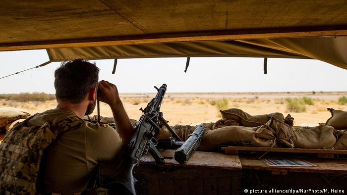 A Bundeswehr soldier secures the perimeter of Camp Castor airfield in Gao, Mali.