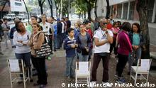 Voters wait outside of a poll station to enter to cast their ballot during the election for a constitutional assembly in Caracas, Venezuela, Sunday, July 30, 2017. President Nicolas Maduro asked for global acceptance on Sunday as he cast an unusual pre-dawn vote for an all-powerful constitutional assembly that his opponents fear he'll use to replace Venezuelan democracy with a single-party authoritarian system. (AP Photo/Ariana Cubillos) |