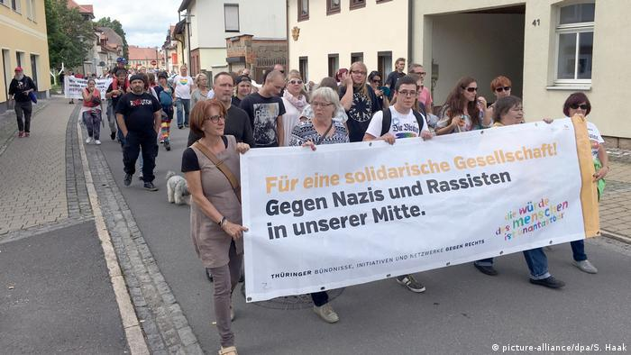 Hundreds of residents rallied against the neo-Nazi supporters for a caring society