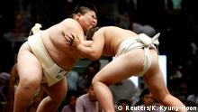 Elementary school sumo wrestlers compete in the sumo ring during the Wanpaku sumo-wrestling tournament in Tokyo, Japan July 30, 2017. REUTERS/Kim Kyung-Hoon