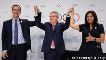 International Olympic Committee (IOC) President Thomas Bach, Mayor of Los Angeles Eric Garcetti and Mayor of Paris Anne Hidalgo gesture during the press conference after the voting at the IOC extraordinary session in Lausanne, Switzerland July 11, 2017. REUTERS/Pierre Albouy