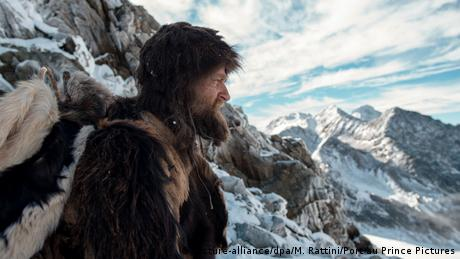 Side profile of bearded man dressed in furs against the backdrop of icy glaciers