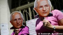 Opposition supporters hold masks of former Caracas mayor and jailed politician Antonio Ledezma as they attend a rally against the National Constituent Assembly, outside a school where a polling center will be established for a Constitutional Assembly election next Sunday, in Caracas, Venezuela, July 24, 2017. REUTERS/Andres Martinez Casares