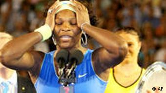Serena Williams of the United States speaks during the awarding ceremony after beating Russia's Dinara Safina, right, in the Women's singles final match against at the Australian Open Tennis Championship in Melbourne, Australia, Saturday, Jan. 31, 2009.