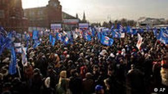 Participants in a rally organized by the main pro-Kremlin United Russia party gather on the Manezh Square next to the Kremlin