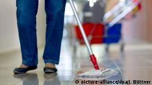 A woman mops the floor