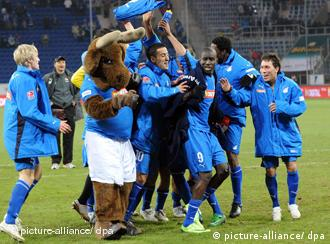 Hoffenheim players celebrate the 2-0 win over Cottbus