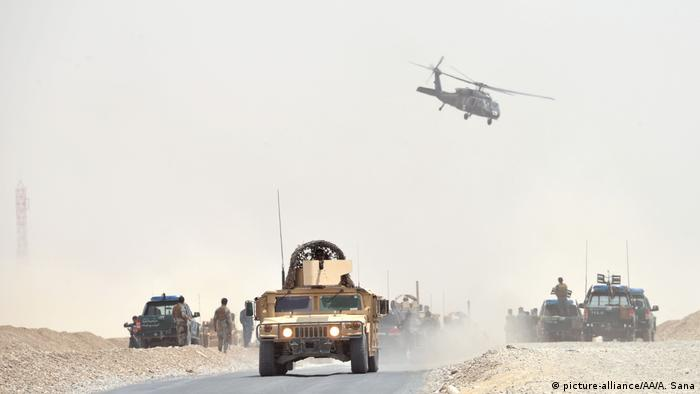The aftermath of an attack on a NATO convoy in Kandahar