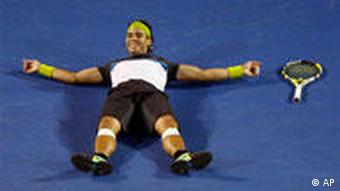Spain's Rafael Nadal celebrates after beating Switzerland's Roger Federer during the Men's singles final match at the Australian Open Tennis Championship in Melbourne, Australia, Sunday, Feb. 1, 2009. (AP Photo/Mark Baker)