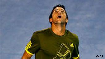 Spain's Fernando Verdasco reacts after losing point against compatriot Rafael Nadal during his Men's singles semifinal match at the Australian Open Tennis Championship in Melbourne, Australia, Friday, Jan. 30, 2009. (AP Photo/Dita Alangkara)