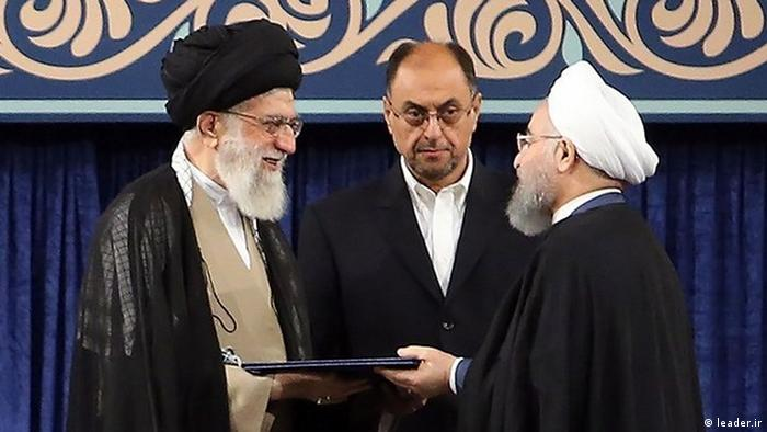 Iran's supreme leader, Ayatollah Ali Khamenei (L), formally endorses President Rouhani (R) for a second term in office