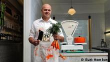 Photo: Jaap Korteweg, the vegetarian butcher, standing in his store in The Hague. (Source: Bart Homburg)