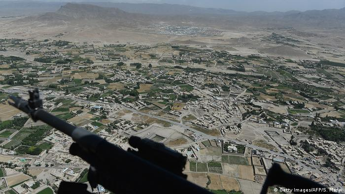 Gardez, capital of Patkia province as seen from onboard an ISAF force helicopter in 2014 machine gun visible at bottom of photo