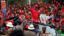 Kenya's president Uhuru Kenyatta waving to supporters during his campaign for re-election (Reuters/B. Ratner)