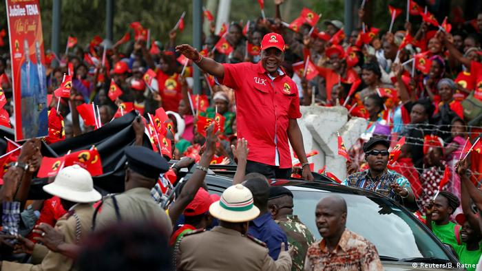 Kenya's president Uhuru Kenyatta waving to supporters during his campaign for re-election