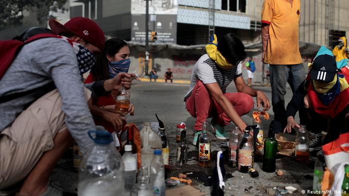 Protesters make petrol bombs as the first sitting of the constituent assembly gets underway