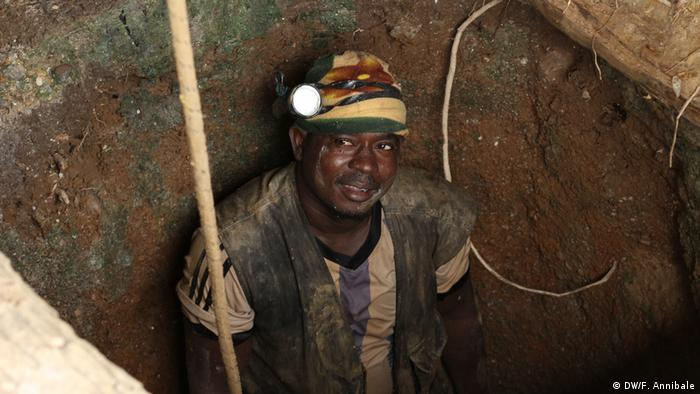A Guinean miner inside a tunnel