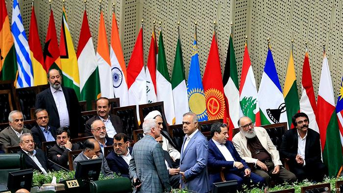 Flags line the parliamentary chamber for the inaguration of Iran's president