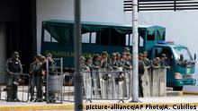 05.08.2017 Venezuelan Bolivarian National Guard officers lineup outside of General Prosecutor headquarters in Caracas, Venezuela, Saturday, Aug. 5, 2017. Security forces surrounded the entrance to Venezuela's chief prosecutor's office early Saturday ahead of a session of the newly-installed constitutional assembly in which the pro-government body is expected to debate the onetime loyalist turned arch critic's removal. (AP Photo/Ariana Cubillos)
