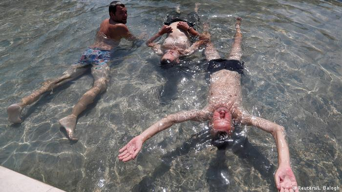 men in water (Reuters/L. Balogh)