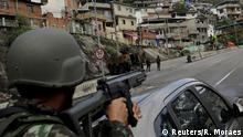 August 5, 2017*** Armed Forces members take up position during an operation against the organized crime in Lins slum complex in Rio de Janeiro, Brazil August 5, 2017. REUTERS/Ricardo Moraes
