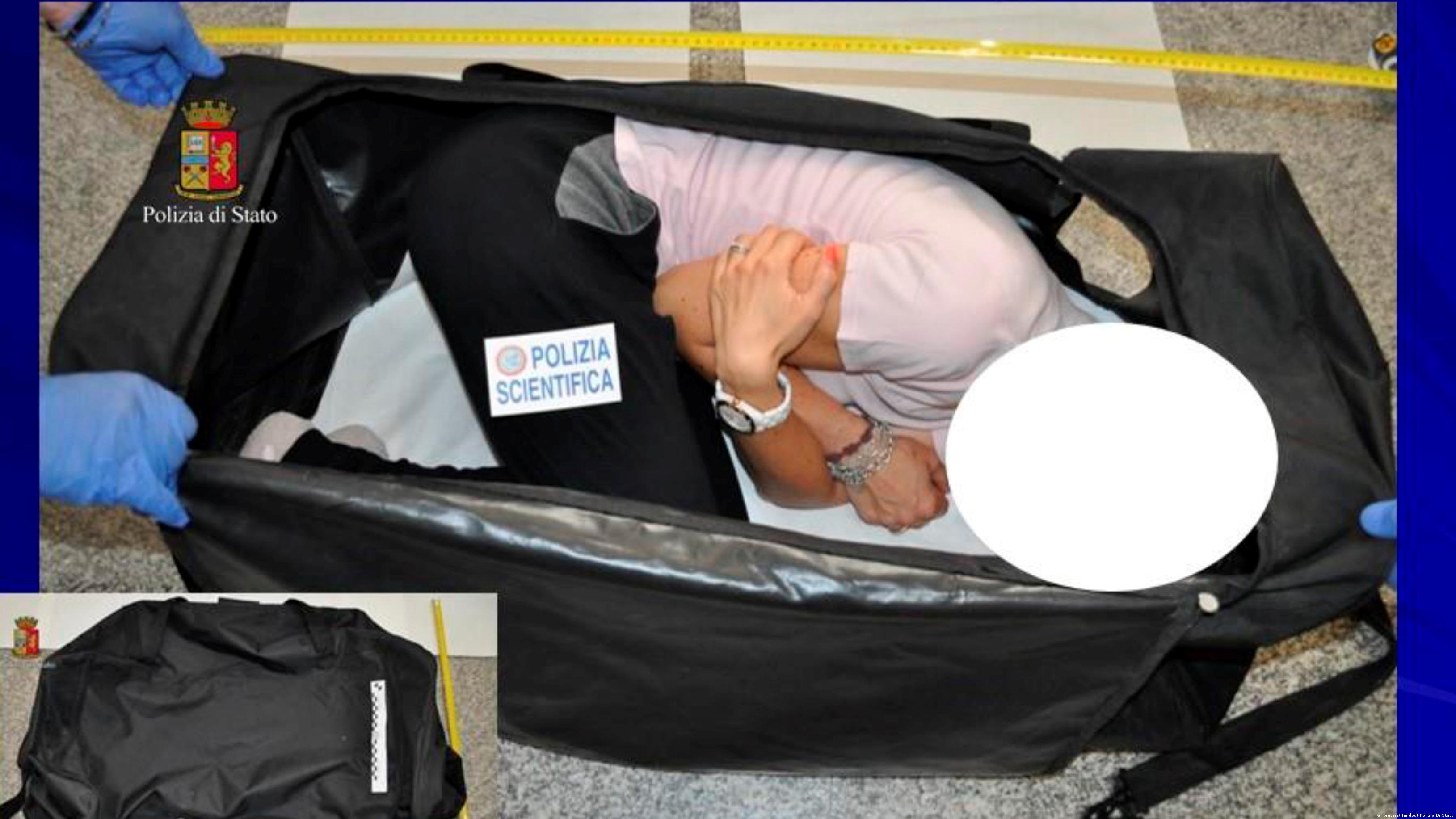 A woman taking part in a re-enactment by Italian police shows how a kidnapped British model was held in a suitcase