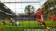 5.8.2017*** DORTMUND, GERMANY - AUGUST 05: Robert Lewandowski of Muenchen scores his team's first goal during the DFL Supercup 2017 match between Borussia Dortmund and Bayern Muenchen at Signal Iduna Park on August 5, 2017 in Dortmund, Germany. (Photo by Alex Grimm/Bongarts/Getty Images )