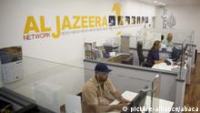 JERUSALEM - JULY 29: Employees of Qatar based news network and TV channel Al-Jazeera are seen on their duty at the Jerusalem office where on July 29, 2017. Prime Minister Benjamin Netanyahu plans to shut down the Jerusalem office of the Al-Jazeera's news network with an unfair accusation of it promotes violence over Temple Mount. Mahmoud Ibrahem / Anadolu Agency |